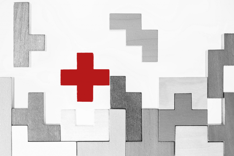 Zusatzmodule: Bild mit Tetris-Steinen in grau und rotem Kreuz als Blickfang